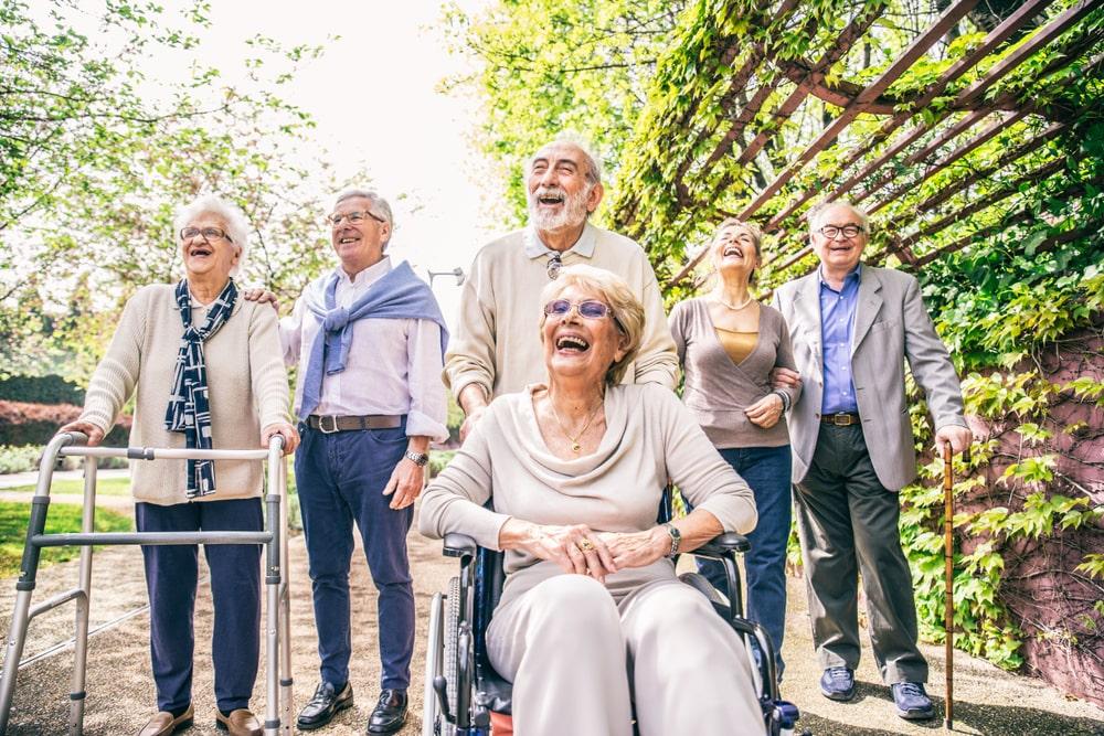 seniors happy at assisted living facility